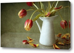 Retro grunge still life of dried flowers in vase against worn wo
