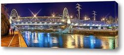 Постер Отражение подсветки моста в реке Сочи