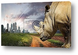 Постер Powerful rhino at sunset. Nature against progress
