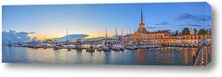 Постер Панорама светящегося морпорта при закате.