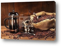 Antique coffee grinder with beans
