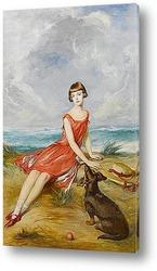 Портрет молодой девушки с ее собакой на берегу моря