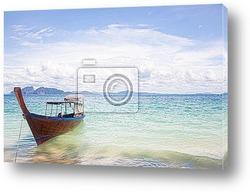 Boat at tropical beach