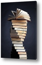 Постер Pile of books on a black background