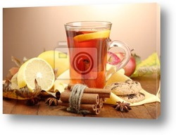 Постер Cup of hot tea and autumn leaves, on brown background