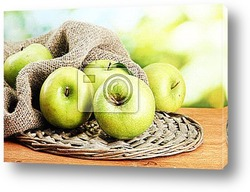 Ripe green apples in basket
