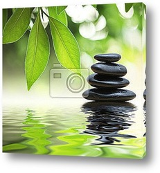 Постер Zen stones pyramid on water surface, green leaves over it