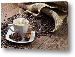 Постер Coffee cup with burlap sack of roasted beans on rustic table