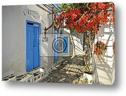 Blue dome church in Oia village on Santorini island, Greece
