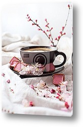 Coffee in white cup on saucer placed on background of coffee bea