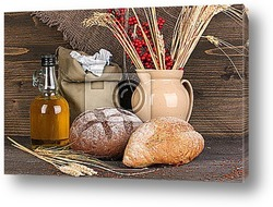 Постер Rye bread on wooden table on wooden background
