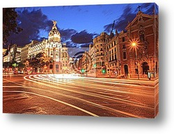 Постер Gran via street in Madrid, Spain at night