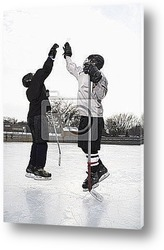 Two boys in ice hockey uniforms giving eachother high five.