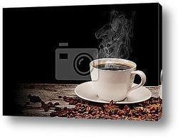 Капля кофе в кофейную чашку