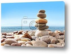 Stack of pebble stones on white