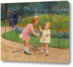 Двое детей собирают цветы