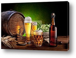 Постер Beer barrel with beer glasses on a wooden table.