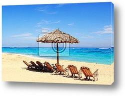 Umbrella with chairs on tropical beach cuba
