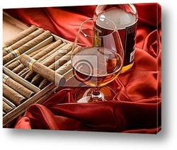 Постер Cuban cigar and bottle of  liquor  over red satin