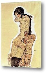 Девушка на коленях,опирающаяся на локти