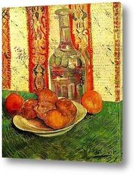 Натюрморт с графином и лемонами на тарелке