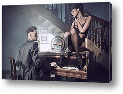 Sexy couple in an intimate situation with piano