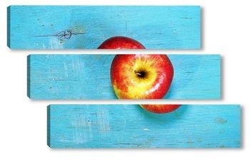 Модульная картина яблоко на голубой деревянной поверхности