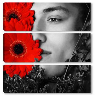 Молодой красивый мужчина и красные цветы