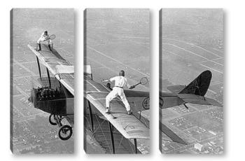Модульная картина Партия в теннис на крыле самолёта.