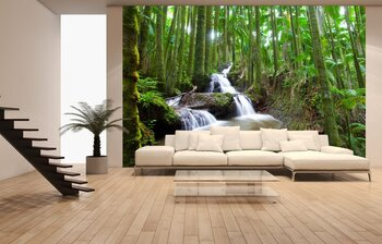 Фотообои Waterfall flowing through tropical palm forest scene